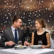Smiling couple eating main course at restaurant — Stock Photo #58109311