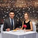 Smiling couple eating dessert at restaurant — Stock Photo #58109515