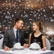 Smiling couple at restaurant — Stock Photo #58109825