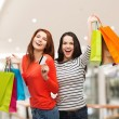 Two smiling teenage girls with shopping bags — Stock Photo #58114581