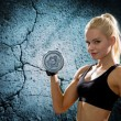 Young sporty woman with heavy steel dumbbell — Foto de Stock   #58116271