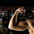 Close up of young man showing biceps — Stock Photo #58116667