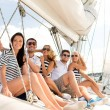 Smiling friends sitting on yacht deck — Stock Photo #58118113