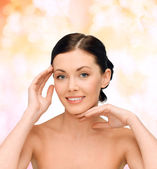Smiling young woman with bare shoulders — Stock Photo