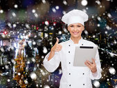 Smiling chef with tablet pc showing thumbs up — Stock Photo