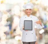 Smiling female chef with tablet pc blank screen — Stock Photo