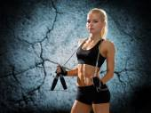 Young sporty woman with jumping rope — Stockfoto