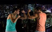 Young men fighting hand-to-hand — Stock Photo