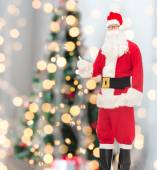 Man in costume of santa claus showing thumbs up — Stock Photo
