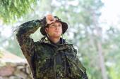 Young soldier or ranger in forest — Stock Photo