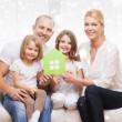 Smiling parents and two little girls at new home — Stock Photo #58297903