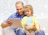 Happy father and daughter with tablet pc computer — Stock Photo