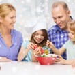 Happy family with two kids making salad at home — Stock Photo #58300245