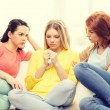 Two teenage girls comforting another after breakup — Stock Photo #58302105
