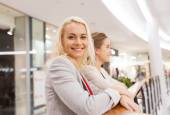 Happy young women in mall or business center — Zdjęcie stockowe