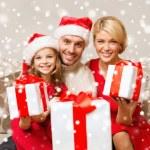 Smiling family holding many gift boxes — Stock Photo #58376437