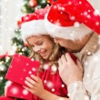 Smiling father and daughter opening gift box — Stock Photo #58376601