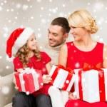Smiling family holding many gift boxes — Stock Photo #58376743