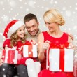 Smiling family holding many gift boxes — Stock Photo #58376783