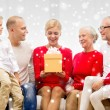 Smiling family with gifts at home — Stock Photo #58378037