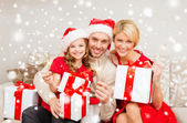 Happy family with gifts and sparklers — Stock Photo