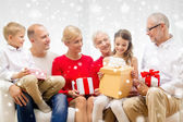 Smiling family with gifts at home — Stok fotoğraf