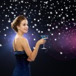 Smiling woman holding cocktail — Stock Photo #58380437