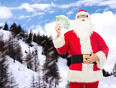 Man in costume of santa claus with euro money — Stockfoto