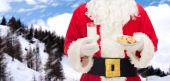 Close up of santa claus with milk and cookies — Stock Photo