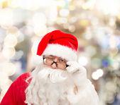 Close up of santa claus winking — Photo
