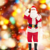 Man in costume of santa claus with bag — Stock Photo