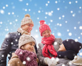 Happy family in winter clothes outdoors — Stock fotografie