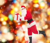 Man in costume of santa claus with gift box — Stock Photo