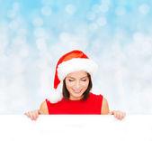 Woman in santa helper hat with blank white board — Photo