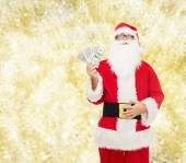 Man in costume of santa claus with dollar money — Stock Photo