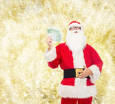 Man in costume of santa claus with euro money — Stock Photo