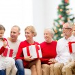 Smiling family with gifts — Stock Photo #58461023