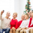 Smiling family with camera at home — Stock Photo #58461109