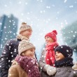 Happy family in winter clothes outdoors — Stock Photo #58462217