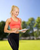 Smiling sporty woman with tablet pc computer — Stock Photo