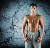 Young male bodybuilder with bare muscular torso — Stock Photo