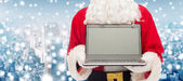 Close up of santa claus with laptop — Stock Photo