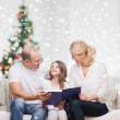 Happy family with book at home — Stock Photo #58618195