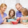 Happy family with two kids making salad at home — Stock Photo #58618413