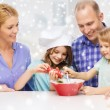 Happy family with two kids making salad at home — Stock Photo #58618429