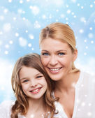 Smiling mother and little girl — Stock Photo