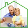 Happy father and daughter with tablet pc computer — Stock Photo #58620459