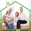 Smiling parents and two little girls at new home — Φωτογραφία Αρχείου #58620485