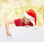 Girl in santa helper hat with blank white board — Stock Photo