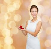 Smiling woman holding red gift box with ring — Stock Photo